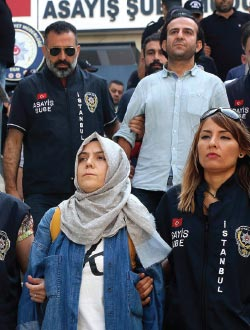 Journalists are escorted to court in Istanbul, after being detained following Turkey's failed coup