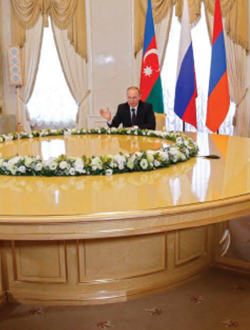 President Vladimir Putin of Russia meets with President llham Aliyev of Azerbaijan (left) and President Serzh Sargsyan of Armenia (right) to discuss the Nagorno·Karabakh conflict , St. Petersburg, Russia, June 2016.